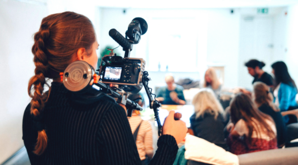 woman filming group of people